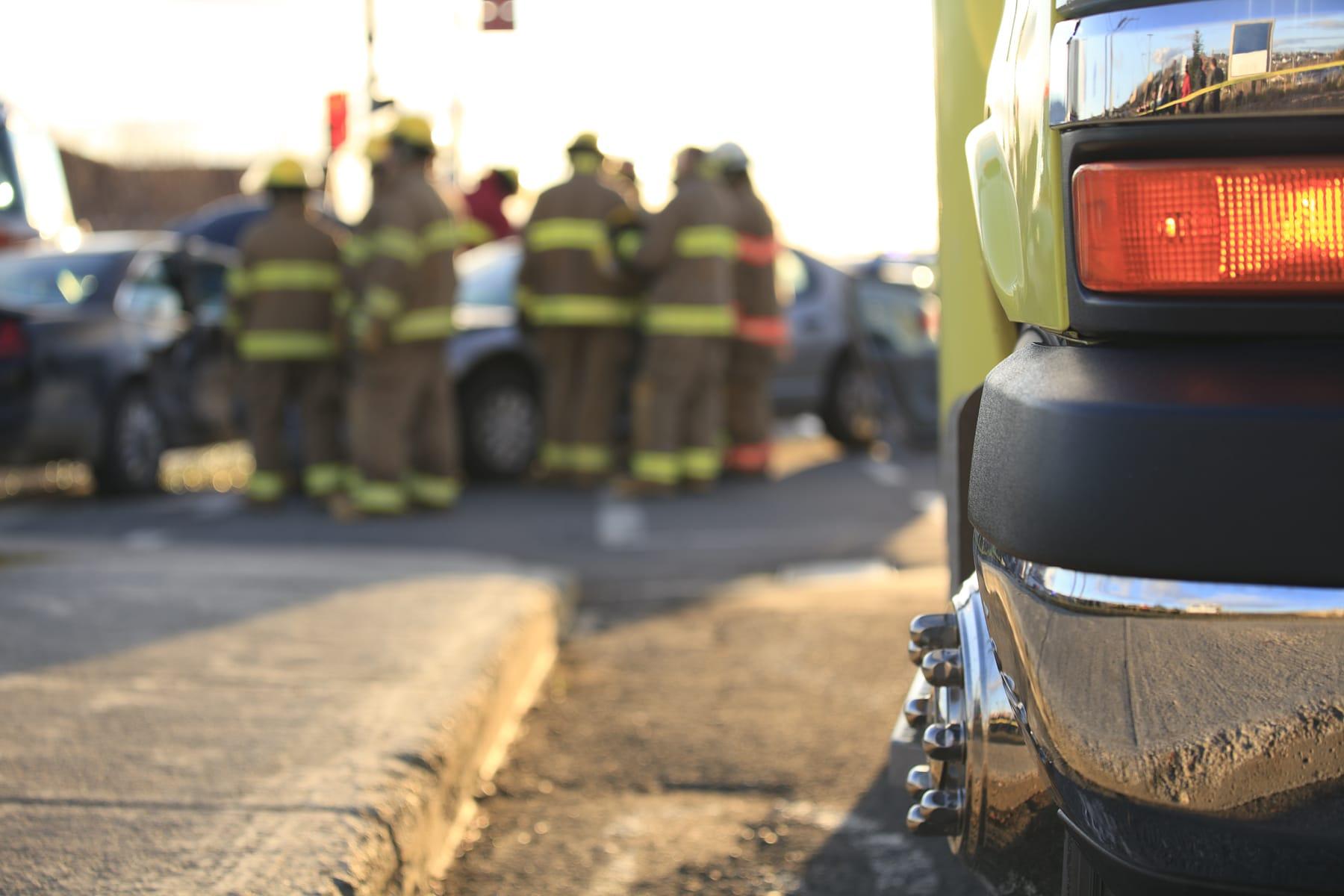 Emergency officials at a car wreck