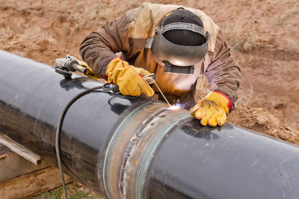 Welder works on pipeline